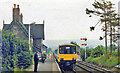 SO0291 : Caersws station, with train, 1986 by Ben Brooksbank