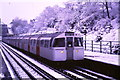 TQ1988 : Jubilee Line in snow at Kingsbury by Malc McDonald