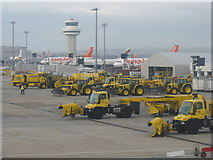 TQ2740 : Snow ploughs, easyJets and ATC tower by M J Richardson