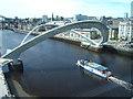 NZ2563 : Boat sailing under the Millennium Bridge by Barbara Carr