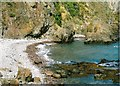 NO7053 : Cliffs and a beach near Boddin Point, Angus by Andrew Diack