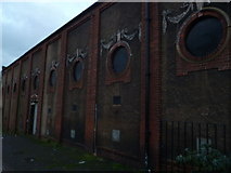 TQ2473 : Wall of Riley's Snooker Hall, Pirbright Road SW18 by Robin Sones