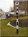 NY7146 : Alston Signpost by David Dixon