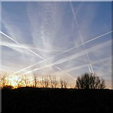 SJ9594 : Early morning contrails by Gerald England