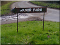 TM4161 : Manor Farm sign by Adrian Cable