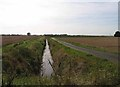 TL3781 : Drain and roadway towards Dunkirk Drove by Andrew Tatlow