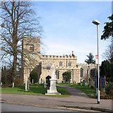 TL4262 : Girton: church, war memorial and bus stop by John Sutton