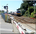 ST0666 : Freight train approaching Rhoose level crossing by Jaggery