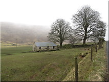 J2024 : A wee cottage facing Wee Roosley across the B25 by Eric Jones