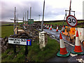 SD9930 : Roadworks at the junction of Haworth Old Road with the A6033 by Phil Champion