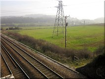 SX8769 : Across the railway line near Langford Bridge by Derek Harper