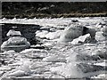 SH6529 : Ice covered rocks on Llyn Du by Dave Croker
