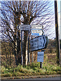TM3864 : Roadsigns on the B1122 Main Road by Adrian Cable