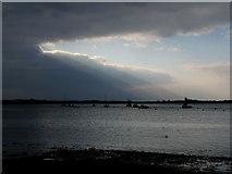 SZ1891 : Hengistbury Head: sunbeams over Christchurch Harbour by Chris Downer