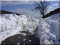 SJ5274 : Road blocked with snow near Riley Bank above Frodsham by John Harrison
