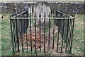 NZ0712 : Iron Railings & a Carved Headstone by Matthew Hatton