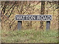 TG1107 : Watton Road sign by Adrian Cable