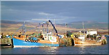 NM5055 : Fishing boats by the pier by Gordon Hatton