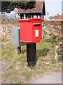 TG2701 : Poringland Post Office Postbox by Adrian Cable