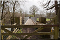 SS5826 : A footbridge over the River Taw at Chapelton by Roger A Smith