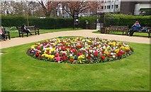 TQ2782 : Flowerbed in St John's Wood church grounds by Paul Gillett