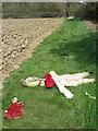 TQ1617 : Body on the Footpath by Simon Carey