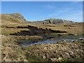 SH6645 : Small pond beneath Moel-yr-hydd by Gareth James