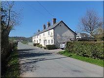 SJ2734 : Row of roadside terrace houses by John Haynes