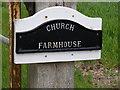 TM3686 : Church Farmhouse sign by Adrian Cable