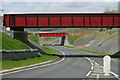 SH6038 : Red Bridges at Minffordd by Peter Trimming