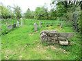SE8979 : Old stone stile in the churchyard by John S Turner