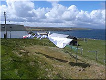 HU5966 : Horizontal washing at Skaw, Whalsay by Oliver Dixon