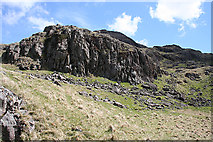 NY2201 : Crags below Hard Knott by Anne Burgess