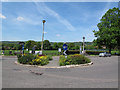 TQ3952 : Floral roundabout, Oxted by Stephen Craven