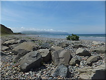 SH4356 : Rocks on the beach at Dinas Dinlle by Richard Hoare