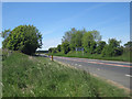 NU0244 : Looking north along the A1 near Bridge Mill by Graham Robson