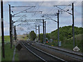 NZ2390 : East Coast Main Line at Ulgham Lane crossing by Alan Murray-Rust