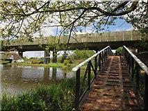 TQ0562 : Footbridge at the canal junction by Derek Harper