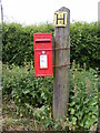 TM1039 : Greensleeves Folly Lane Postbox by Adrian Cable