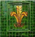 TQ3390 : Ceramic fleur-de-lys, Tottenham by Julian Osley