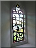 SU5355 : All Saints, Hannington: tinted window by Basher Eyre