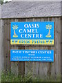 TM3078 : Oasis Camel Centre sign by Adrian Cable