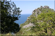 SS7049 : Castle Rock from the South-West Coast Path by Steve Daniels