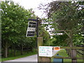 TM3178 : Signs at the entrance to Grove Farm by Adrian Cable