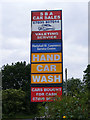 TM3883 : Ilketshall St.Lawrence Service Station sign by Adrian Cable