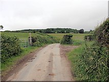 SJ2428 : Gates and footpath from Pentregaer lane by John Firth