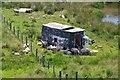 NT3922 : Derelict caravan with sheep by Jim Barton