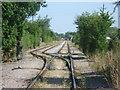 TQ7274 : Railway line to Brett Gravel Works by Marathon
