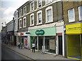 TL1860 : High Street shops, St Neots by M J Richardson