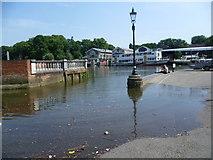 TQ1673 : The River Thames flooding across the road at Twickenham by Marathon